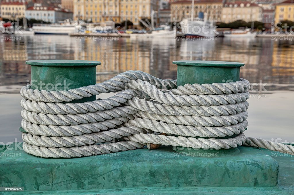 Bollards and white rope royalty-free stock photo