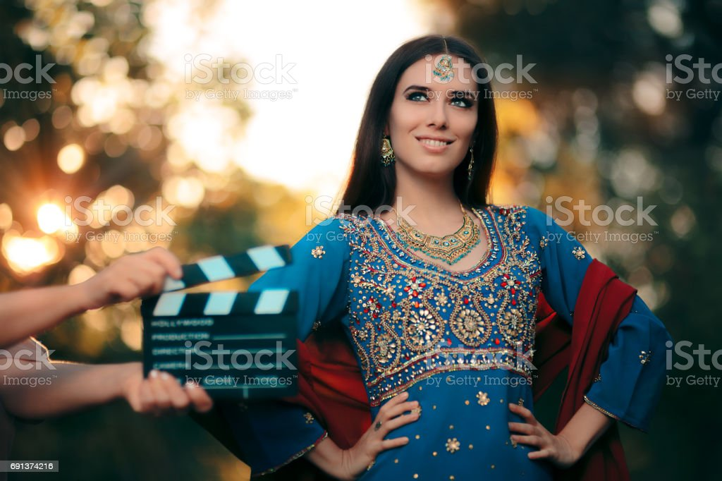 Bollywood Actress Wearing an Indian Outfit with Gold Jewelry Set stock photo