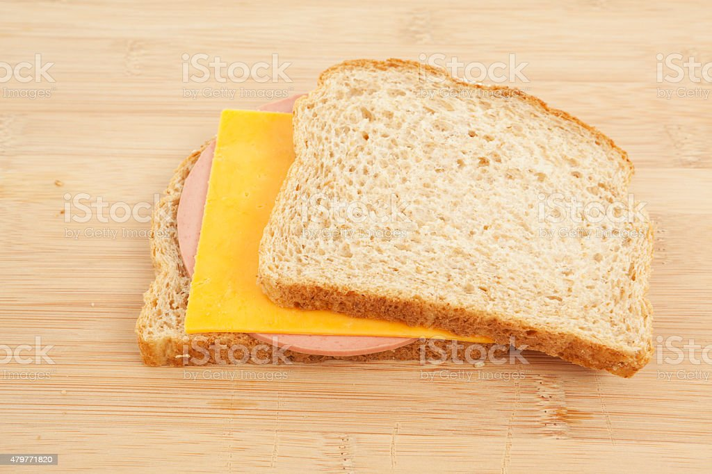 Bologna and Cheese Sandwhich on Wheat Bread stock photo