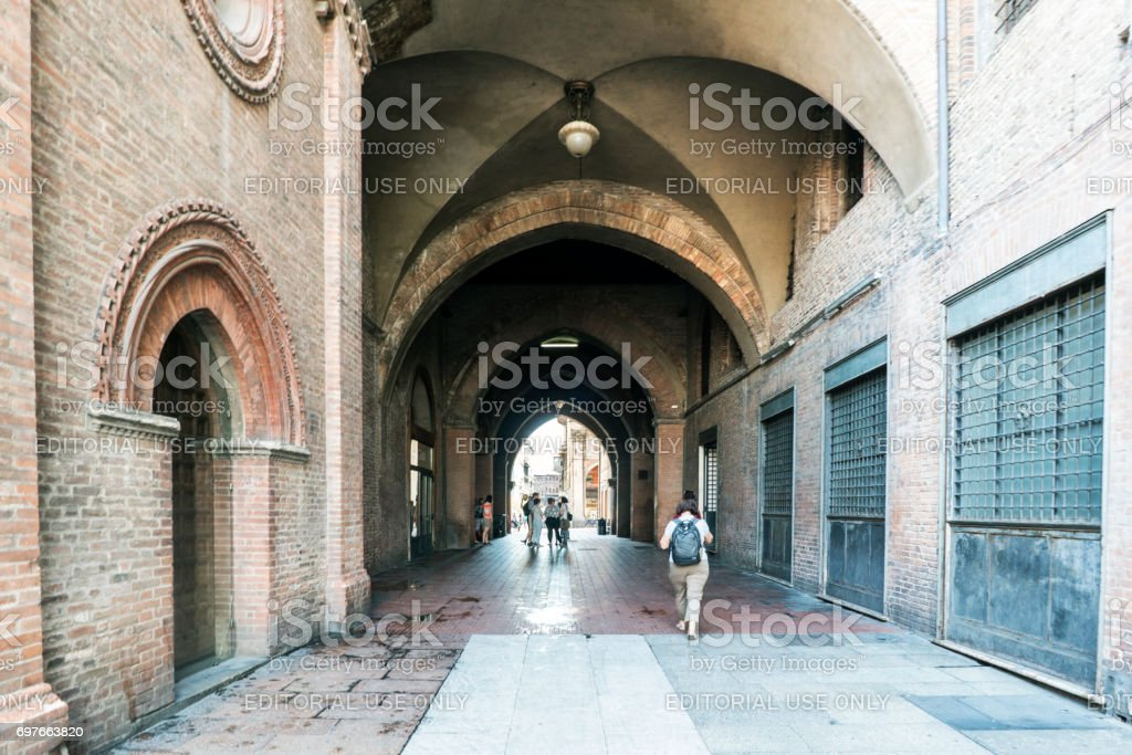Bologna, Emilia-Romagna, Italy. May 21, 2017. View of the tunnel in the palace 'Re Enzo' between the Plaza 'Maggiore' and Rizzoli Street stock photo