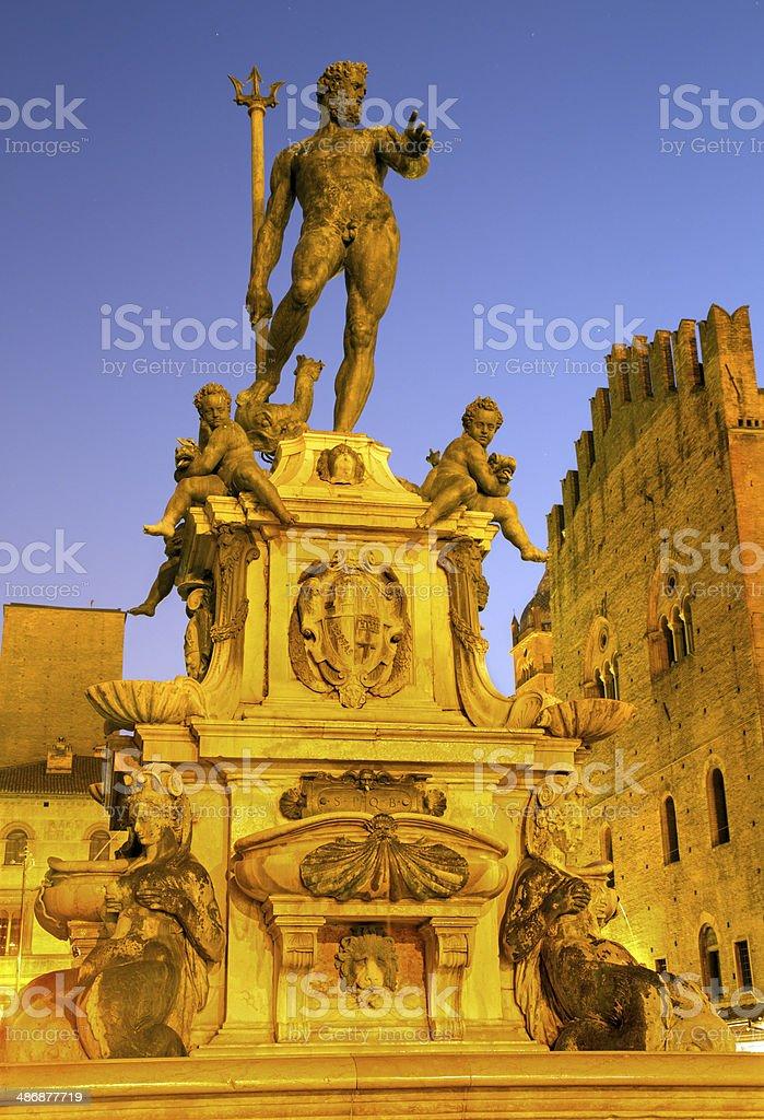 Bologna - Neptune fountain on Piazza Maggiore square in dusk stock photo