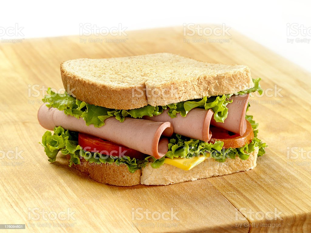 Bologna Sandwich on a Cutting Board stock photo