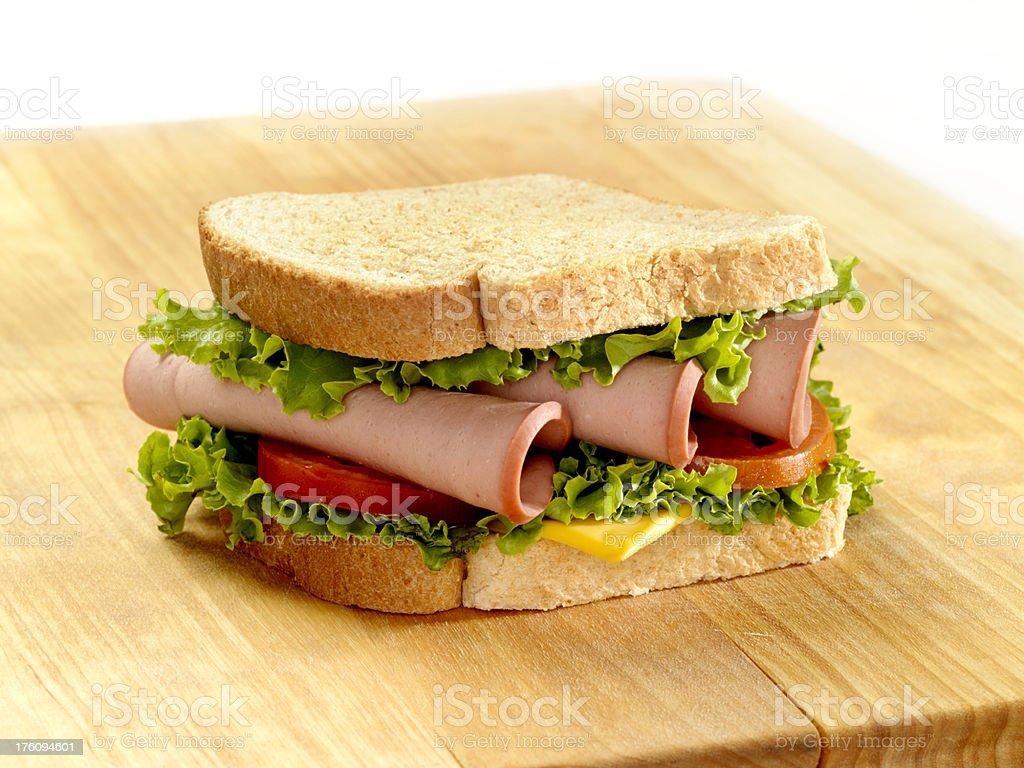 Bologna Sandwich on a Cutting Board stock photo