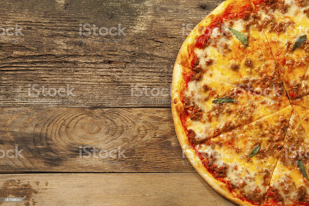 Bolognese pizza on wooden table. stock photo