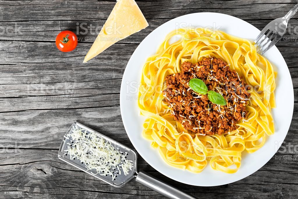 Bolognese ragout with italian pasta on a white plate, close-up stock photo