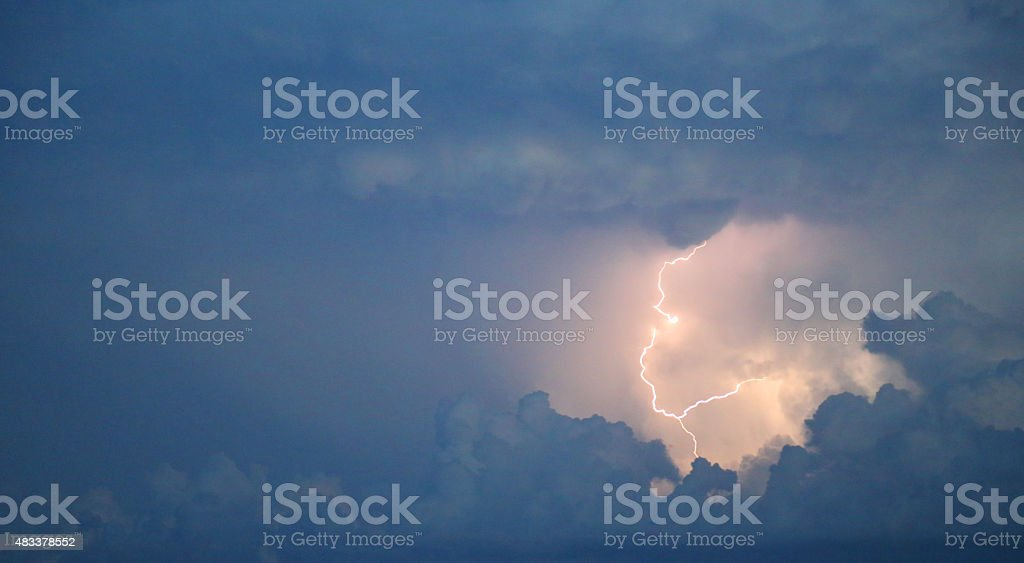 Bolt of lightning during a thunderstorm stock photo