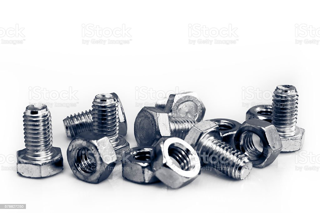 Bolts and nuts on the table stock photo