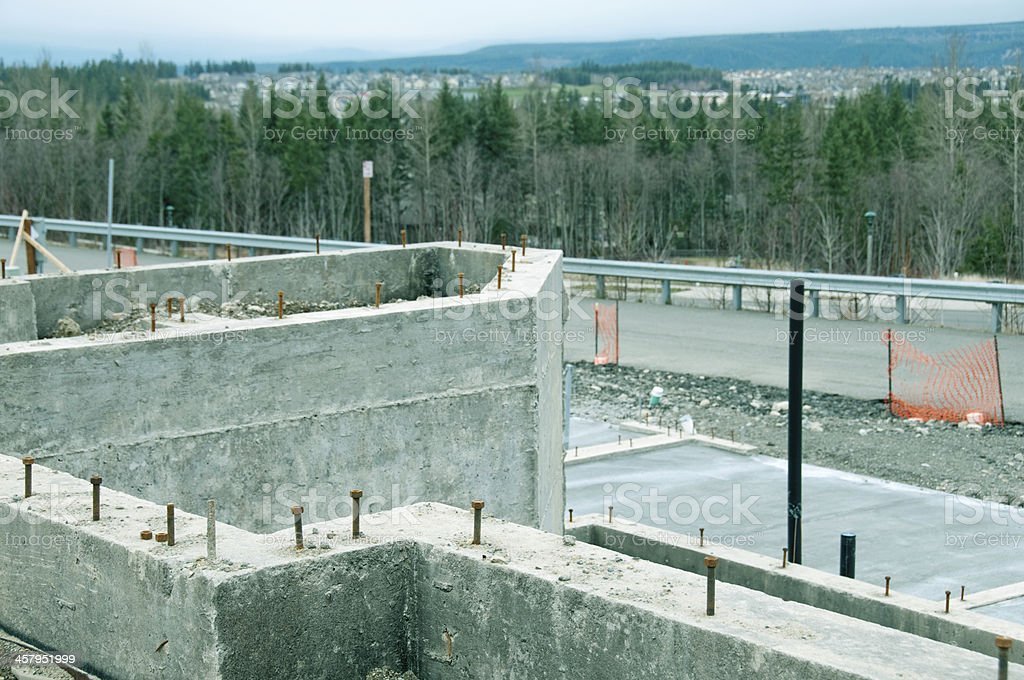 Bolts in concrete for securing house to foundation royalty-free stock photo