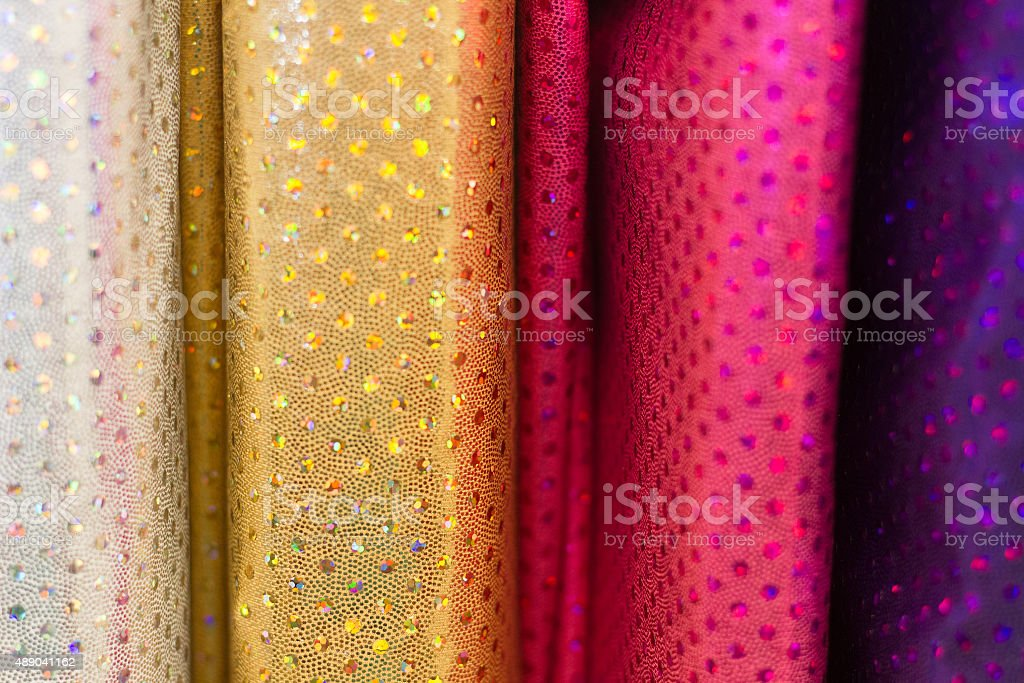 Bolts of Bright, Sparkly Fabric (Close-Up) stock photo