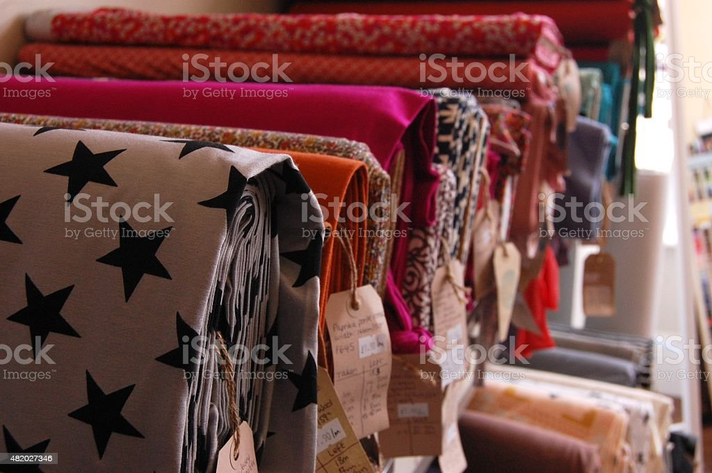 Bolts of patterned fabric stock photo