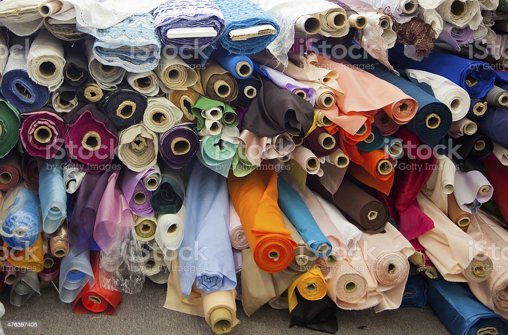 Bolts/rolls of various colored fabric stock photo