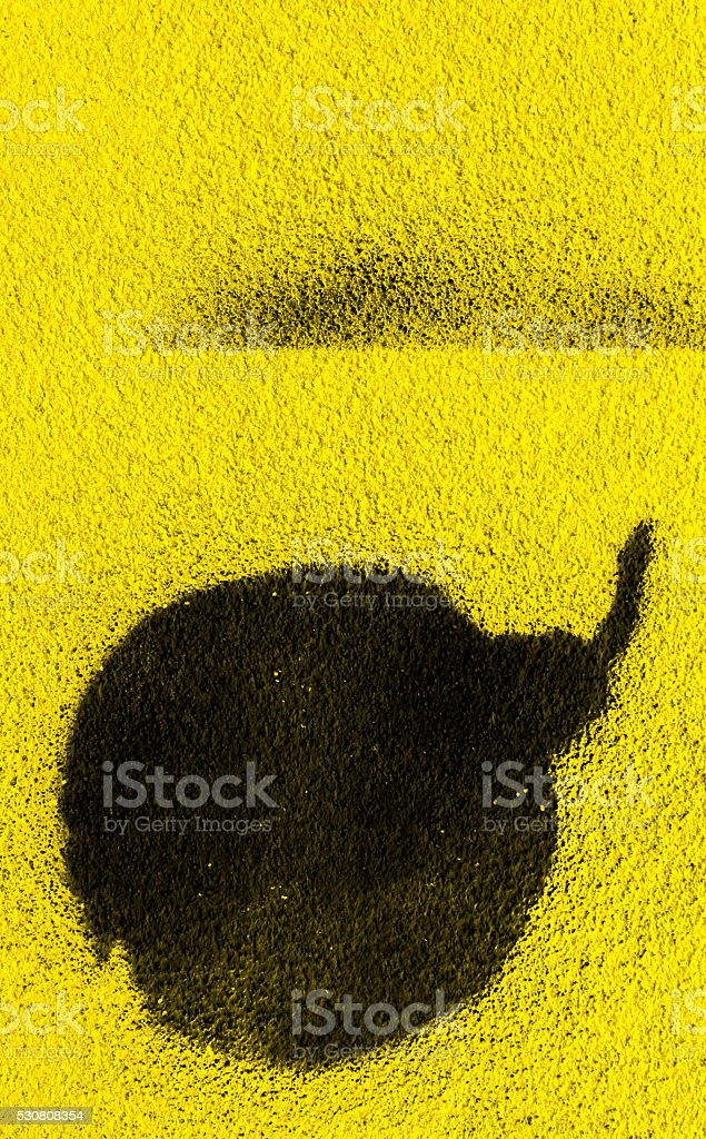 Bomb on yellow backdrop stock photo