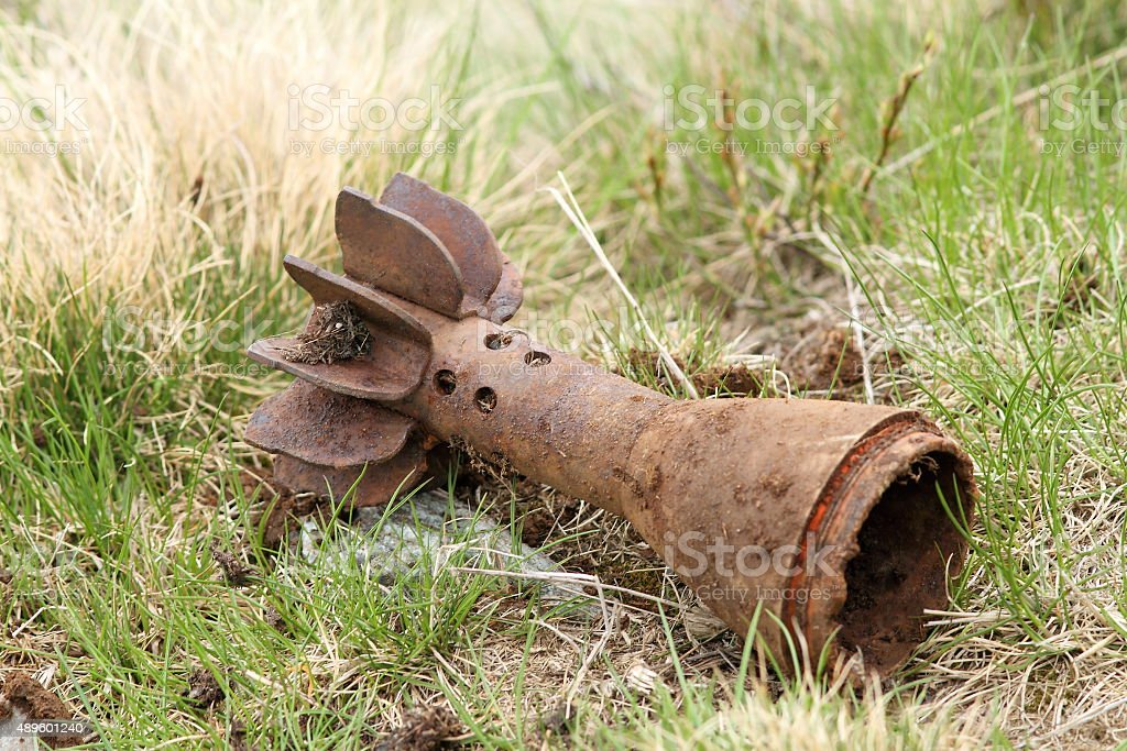 bomb shell case left in the field stock photo