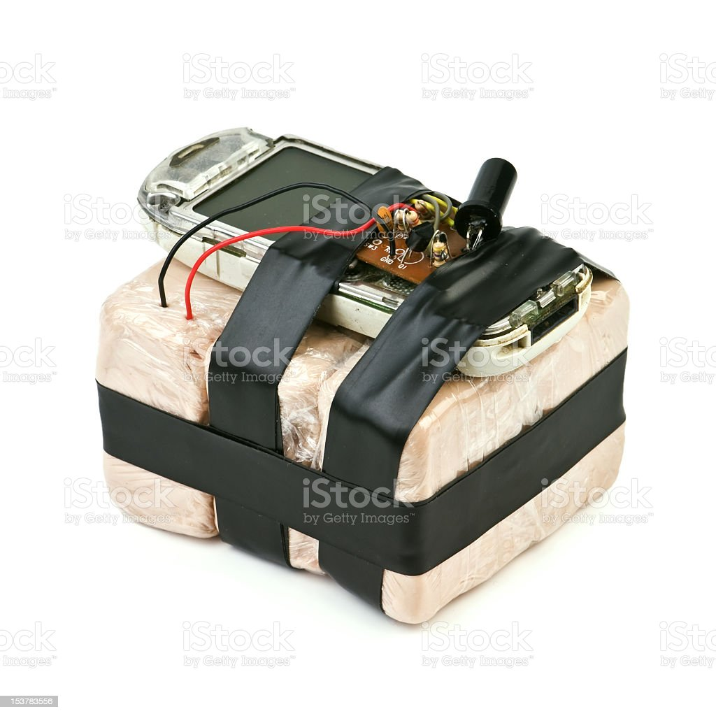 Bomb strapped to a detonator on a white background stock photo
