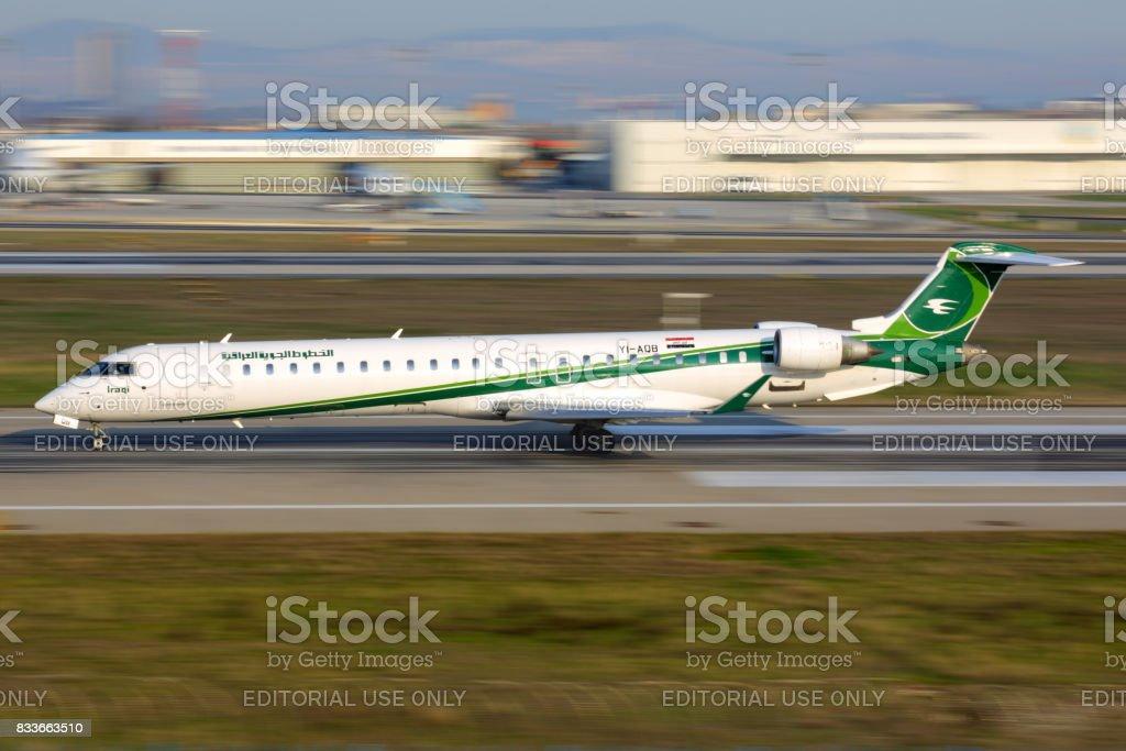 Bombardier CRJ-900 YI-AQB of Iraqi Airways taking off at Ataturk international airport. stock photo