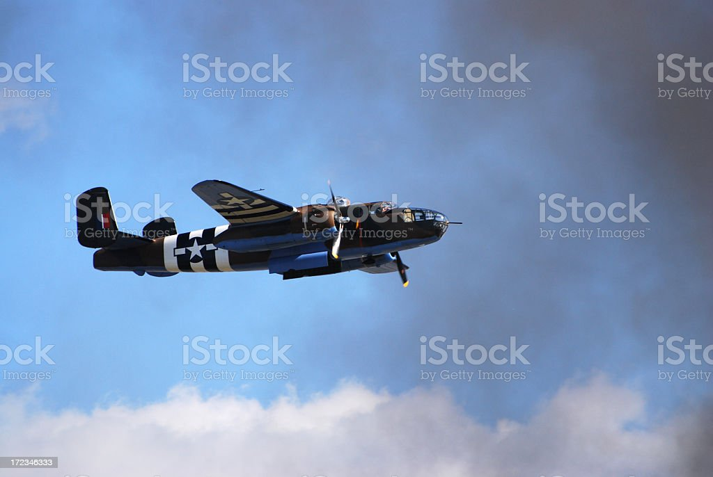 WWII B25 bomber airplane flying in sky royalty-free stock photo