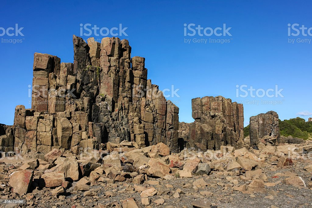 Bombo quarry igneous rock columns stock photo