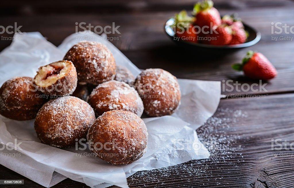Bomboloni - Italian doughnuts stuffed with strawberry jam stock photo