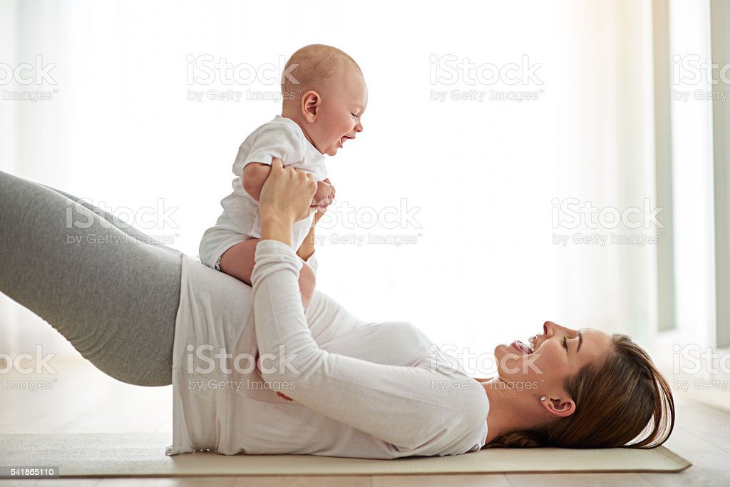 Bonding with baby while getting back into shape stock photo