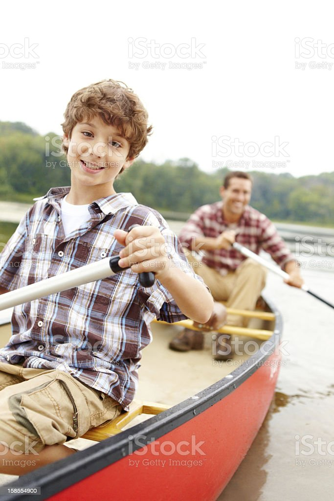 Bonding with his dad on the river royalty-free stock photo