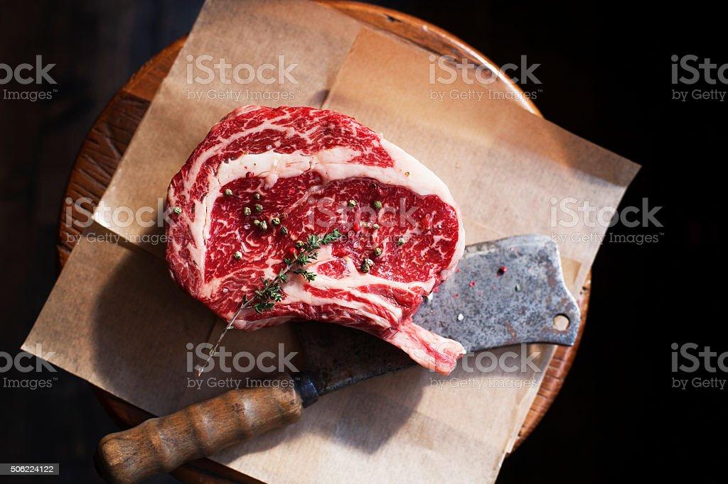 Bone In Rib Eye row Steak and knife stock photo