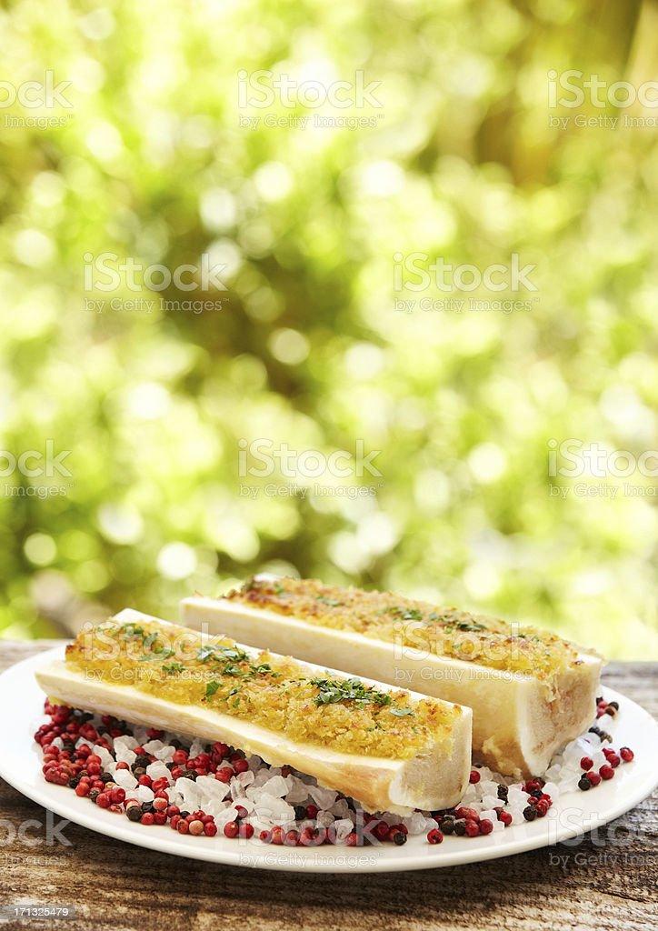Bone marrow with parsley on top of rock salt outdoors stock photo