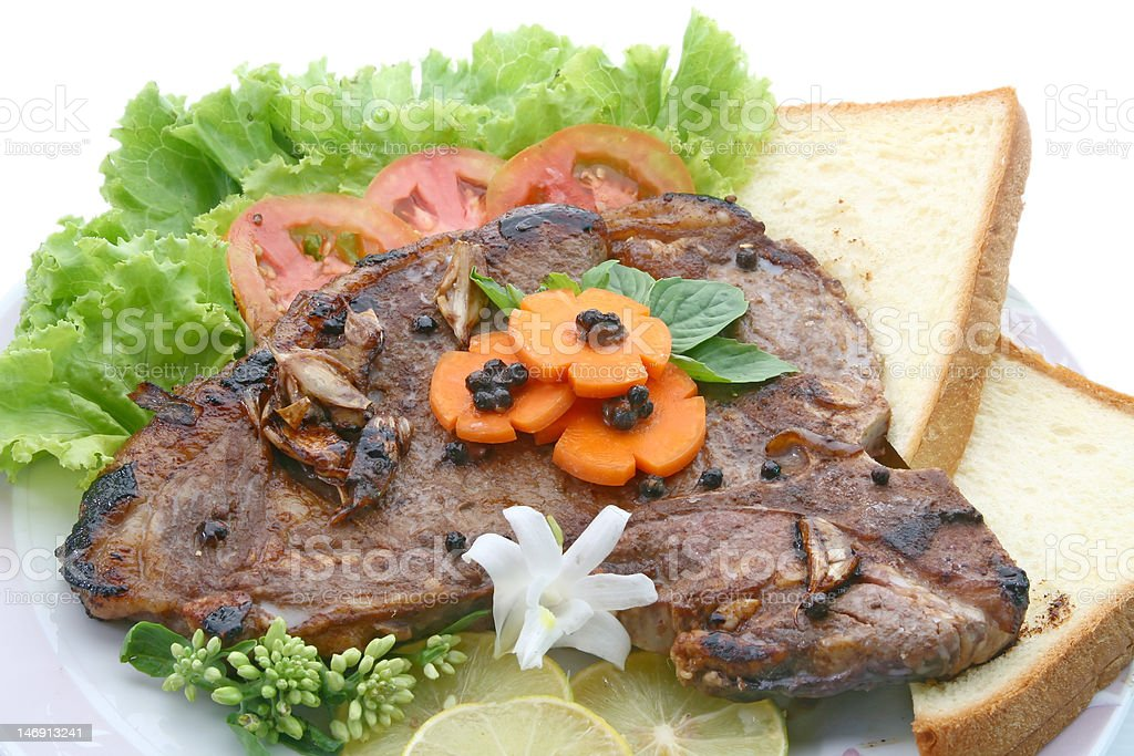 T Bone Pepper Steak with vegetable and bread royalty-free stock photo