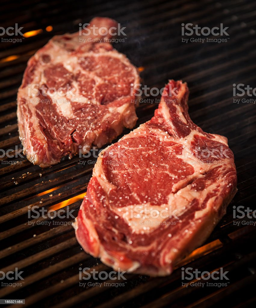 Bone-in rib eyes stock photo