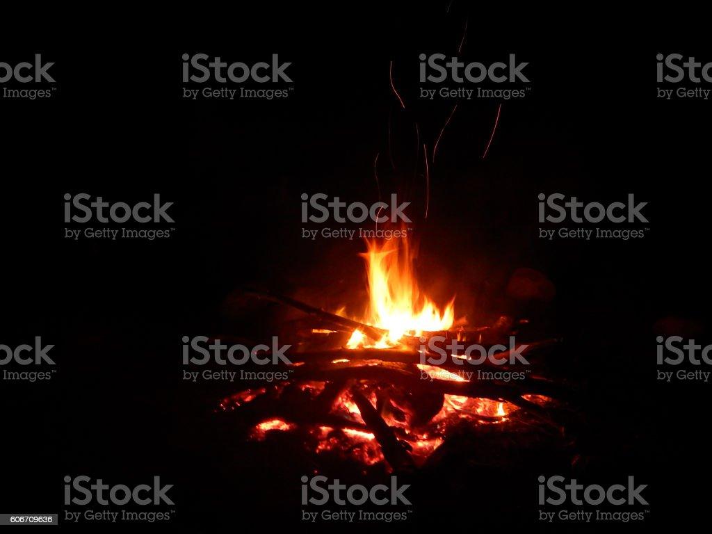 Bonfire at night.  Black background.  Copy space.  Horizontal. stock photo