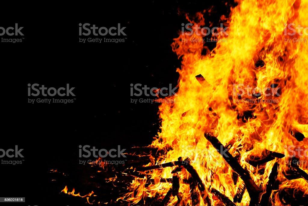 Bonfire burning trees, wood burnt at night. stock photo