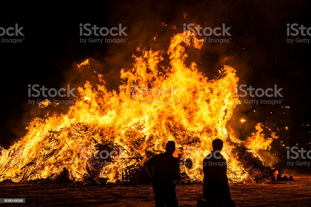 Bonfire on a beach at night, Costa Brava, Spain stock photo