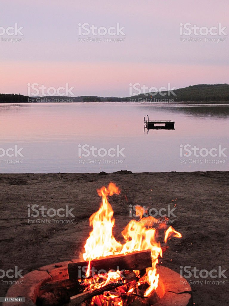 Bonfire on the beach at sunset royalty-free stock photo