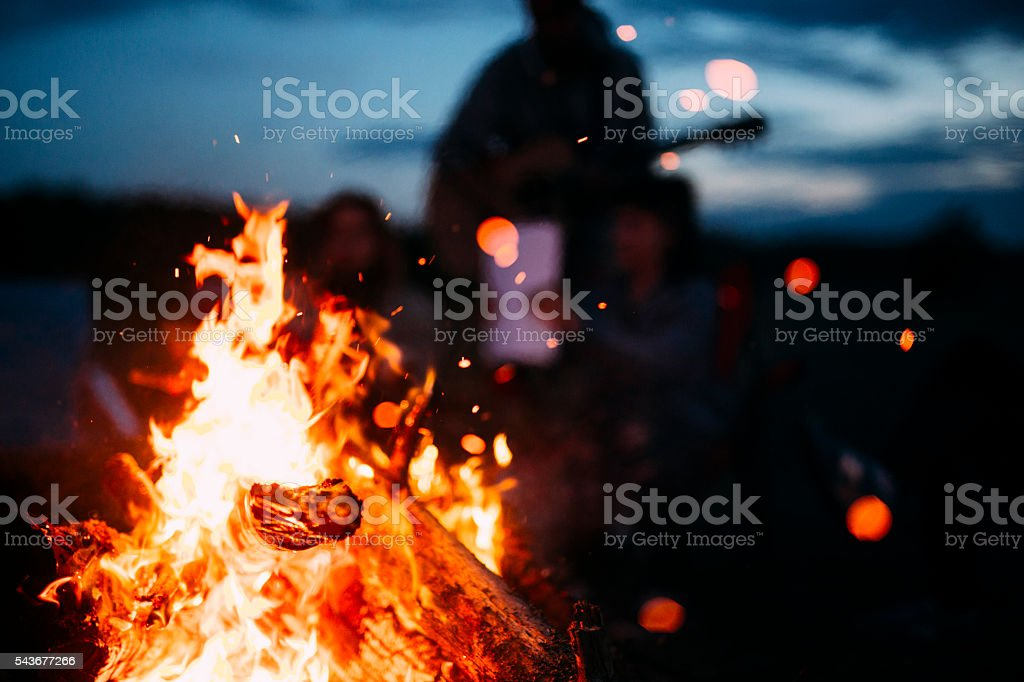 Bonfire with sparks flying around stock photo