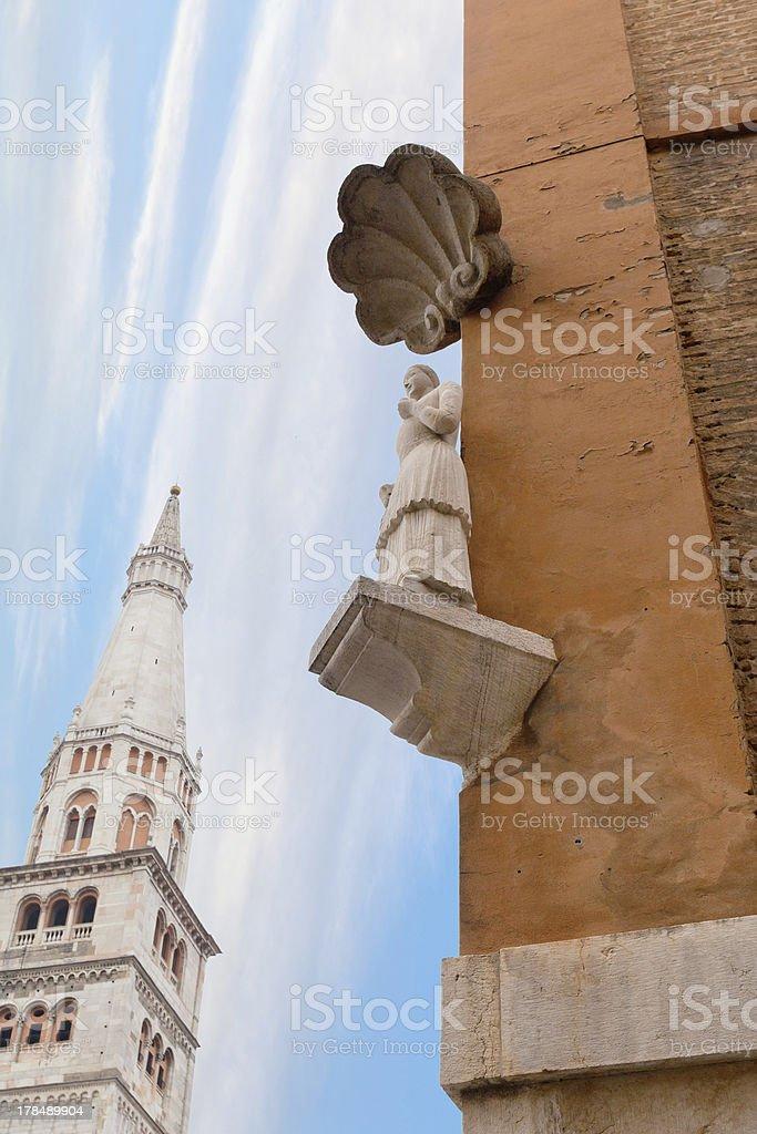 Bonissima is medieval statue on the corner of ModenaTown Hall stock photo