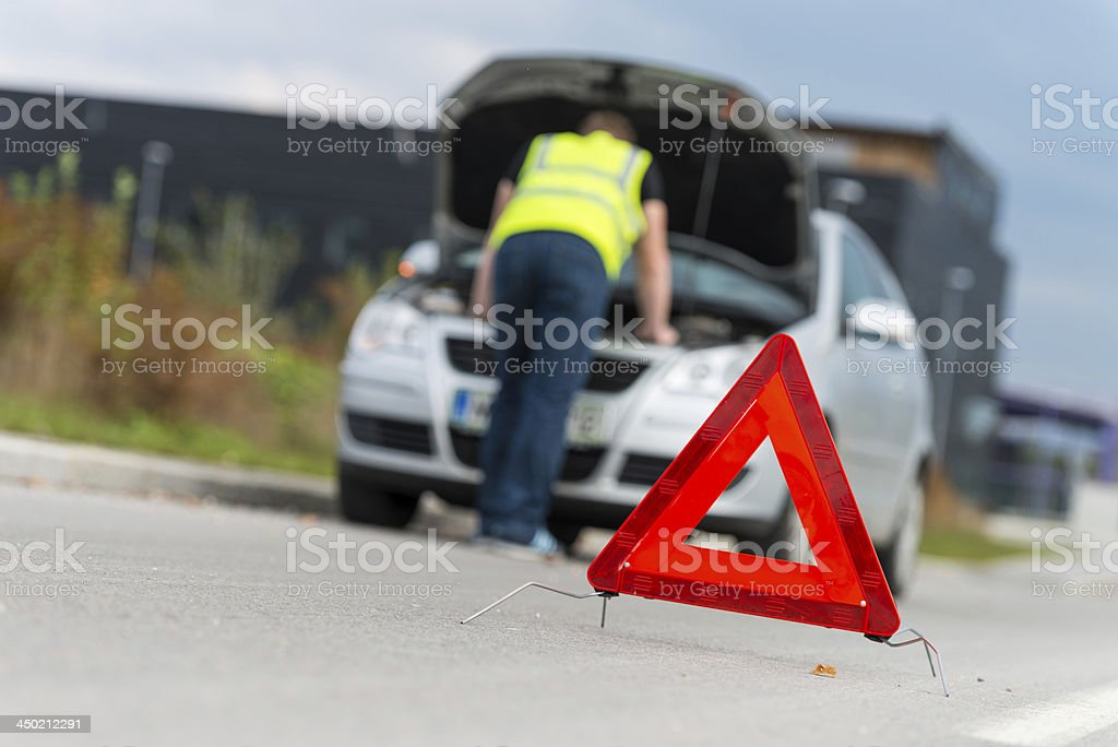 Bonnet raised of broken down vehicle and warning triangle stock photo