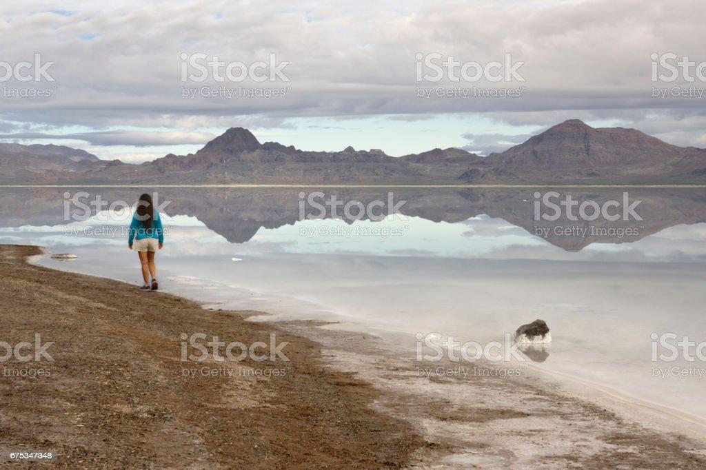 Bonneville Salt Flats Silver Island Mountains desert reflection woman explores Utah stock photo