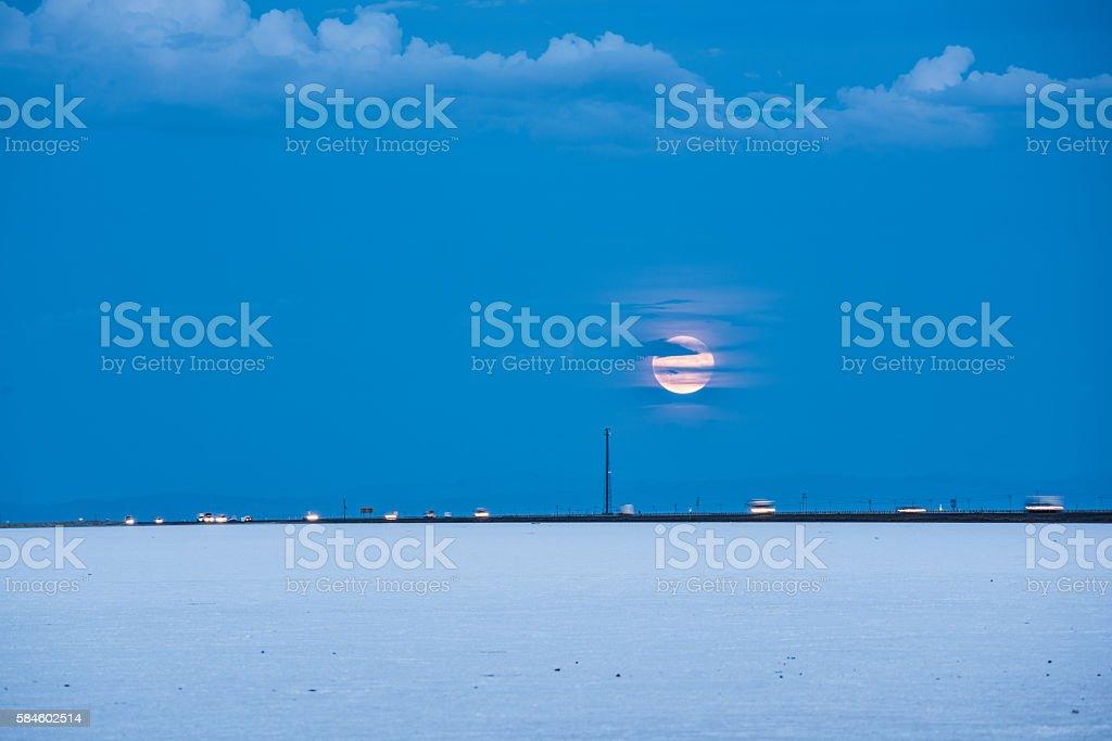 Bonneville White Salt Flats with supermoon stock photo