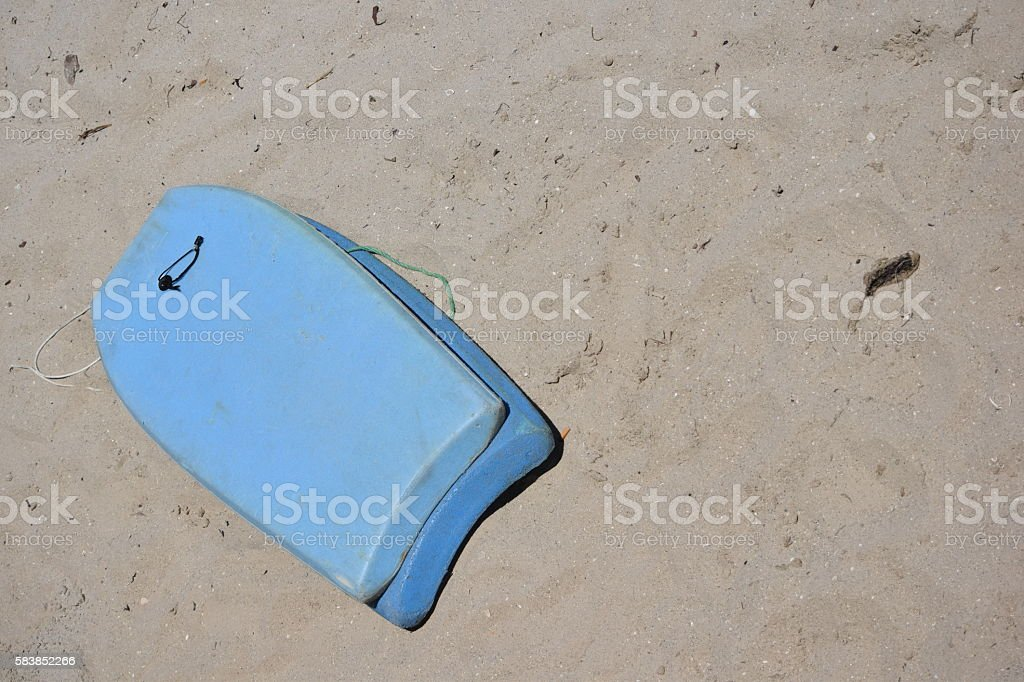 Boogie Boards Stacked on Beach Sand stock photo