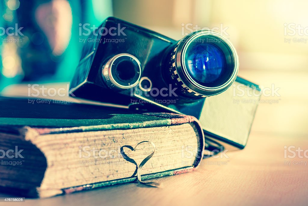 book and an ancient video camera stock photo