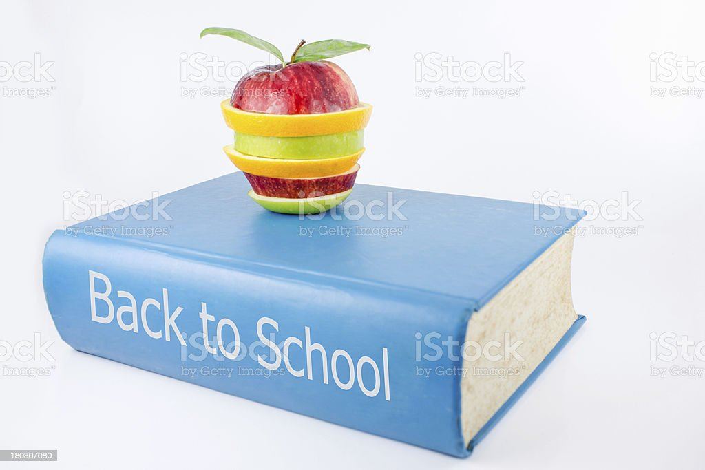 book and an fruits on a white background royalty-free stock photo