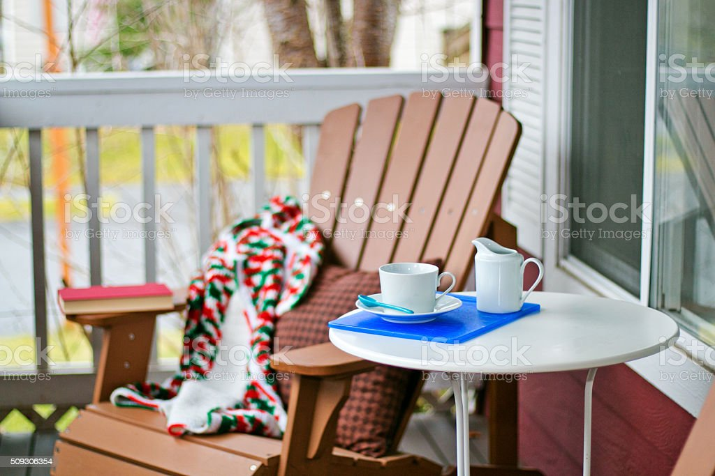 Book and Coffee on a Cozy Porch stock photo