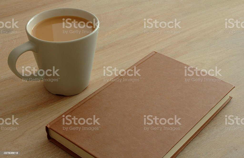 Book and coffee on a table stock photo