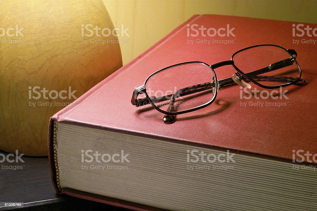 Book and glasses under lamp royalty-free stock photo