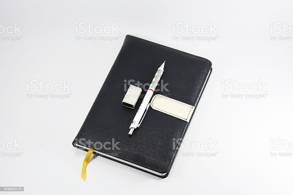 Book and pen Isolated on a white background. stock photo