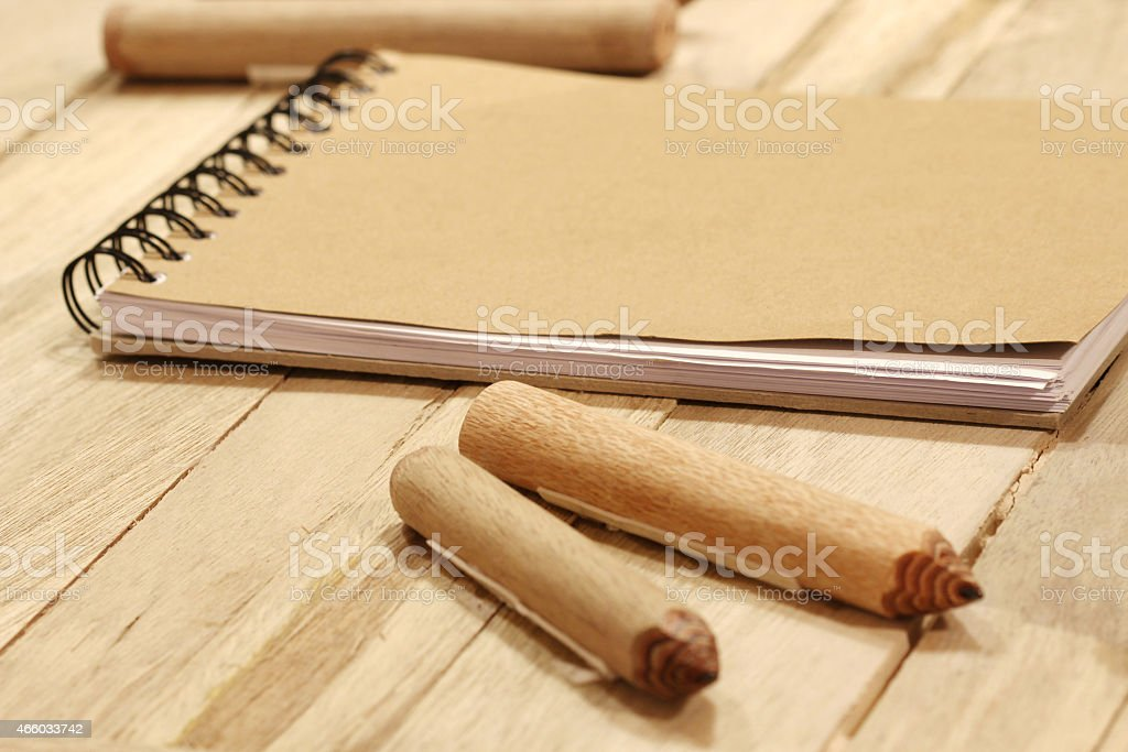 book and pencil on wood table stock photo