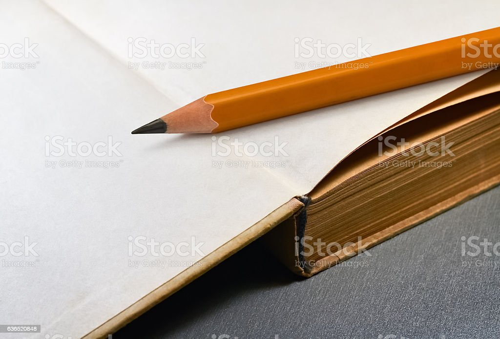 Book and pencil stock photo