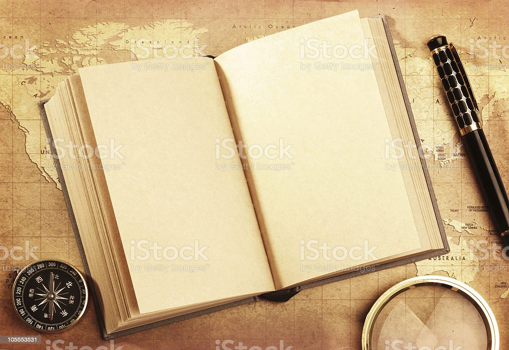 book and pen,compass, magnifying glass  on map royalty-free stock photo