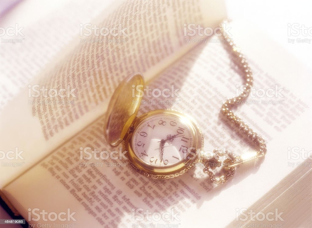 book and pocket watch royalty-free stock photo