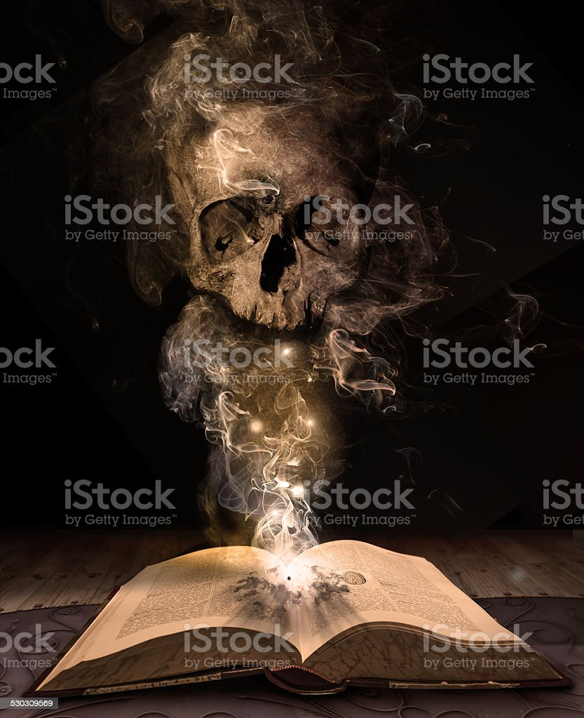 book and skull stock photo