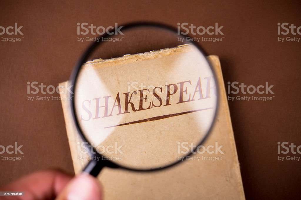 Book by Shakespeare Seen under Loupe stock photo